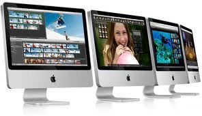 Four Apple IMac Computers Next to Each Other