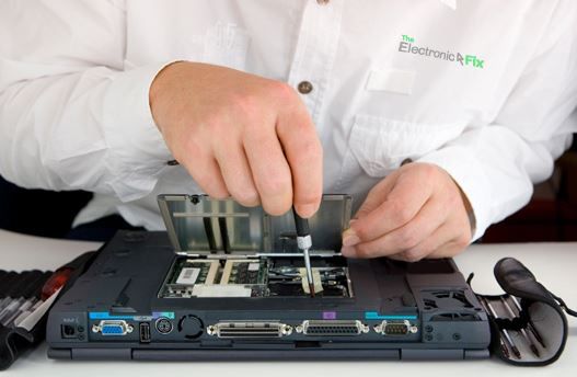 The Electronic Fix computer technician repairing a laptop
