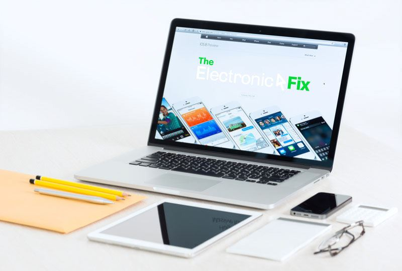 laptop screen on a desk with The Electronic Fix brand logo