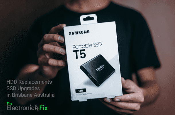 person holding a box of Samsung portable SSD