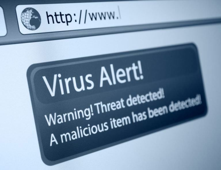 virus alert on a laptop screen